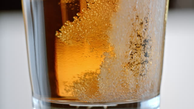 slo mo beer being poured into a pint - pouring stock videos & royalty-free footage