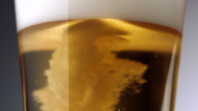 cu tu slo mo beer being poured into beer glass / new york city, new york, usa   - empty beer glass stock videos and b-roll footage