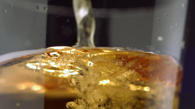 CU SLO MO Beer being poured into beer glass / New York City, New York, USA