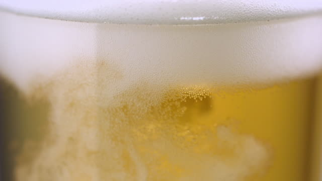 ECU SLO MO Beer being poured into beer glass / New York City, New York, USA