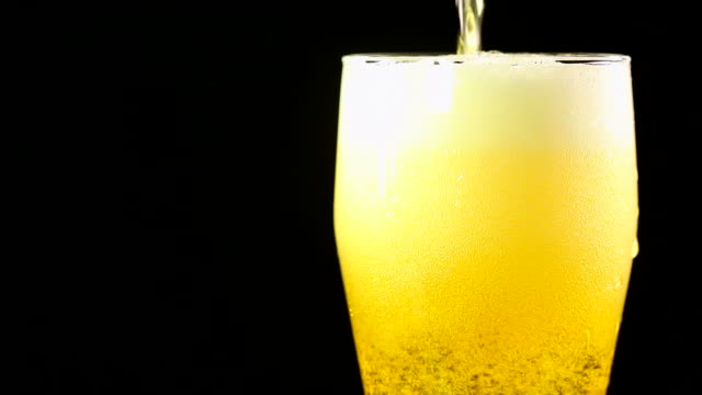 beer being poured into glass - frische stock videos & royalty-free footage