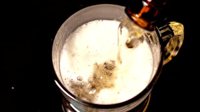 beer being poured into glass - lager stock videos & royalty-free footage