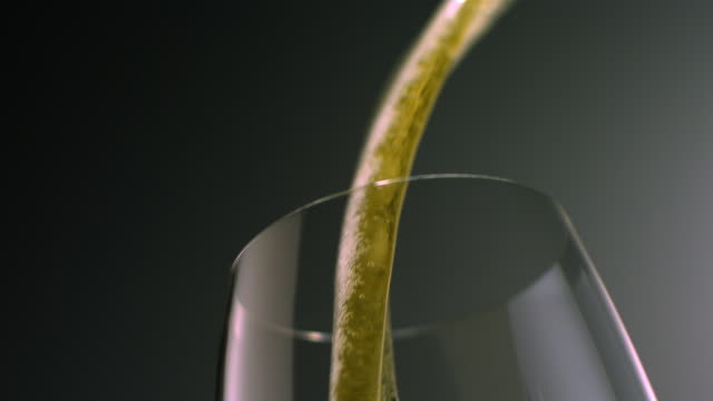 slo mo cu la beer being poured into glass - füllen stock-videos und b-roll-filmmaterial