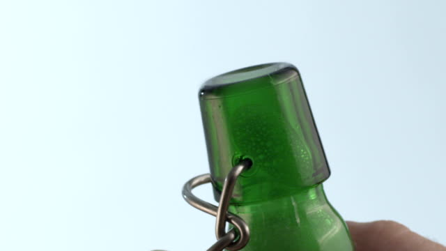 Beer bottle opening close-up