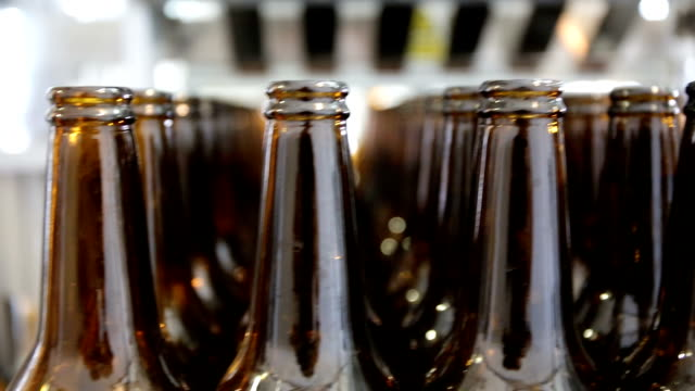 beer bottles panorama - alcohol abuse stock videos & royalty-free footage
