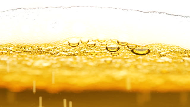 beer bubbles and foam closeup - bar drink establishment stock videos & royalty-free footage