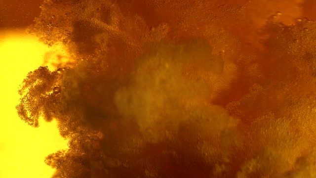 beer bubbles extreme close up - frothy drink stock videos & royalty-free footage