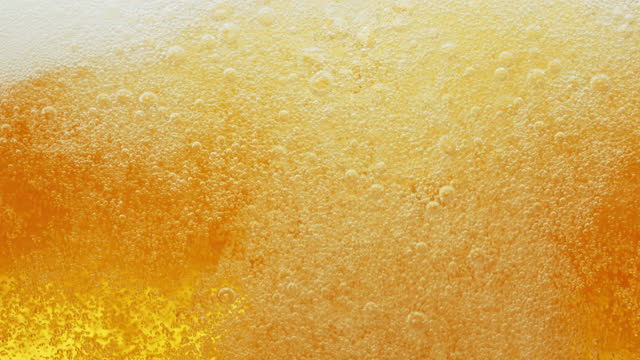 beer bubbles flowing fast and settling in reverse - wet stock videos & royalty-free footage