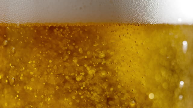 SLO MO Beer bubbles in a glass