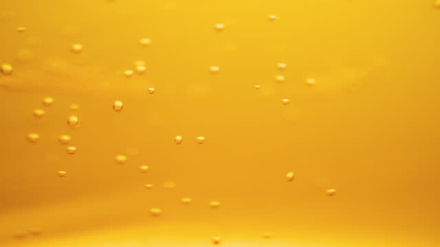 beer bubbles slow-motion background - carbonated stock videos & royalty-free footage