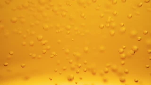 ビールバブルスローモーションの背景 - carbonated点の映像素材/bロール