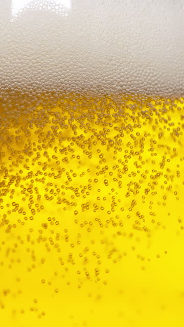 beer close up in slow motion - frothy drink stock videos & royalty-free footage