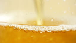 Beer close up with foam and bubbles