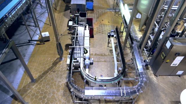 Beer factory interior with conveyer belt