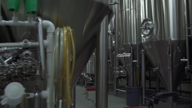 vídeos de stock, filmes e b-roll de beer fermenters in a brewery - aço inoxidável