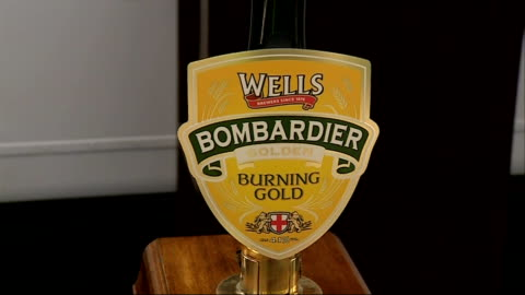 beer festival at olympia; crdboard cutout figure of rik mayall advertising 'bombardier' / wells bombardier pumps / pint of bombardier / gvs... - rik mayall stock videos & royalty-free footage