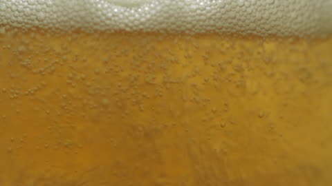 beer filling a glass macro - filling stock videos & royalty-free footage