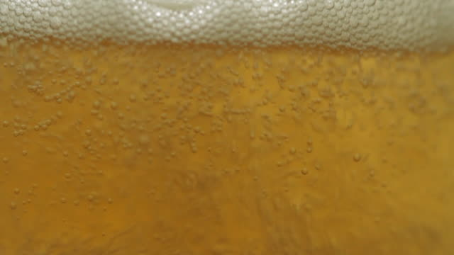 beer filling a glass macro - amber stock videos & royalty-free footage