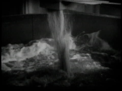 1936 B/W Beer flowing into vat at the Anheuser Busch brewery in St. Louis / Missouri, United States