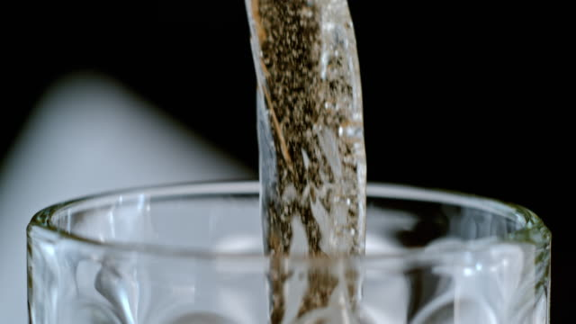 slo mo beer forming bubbles as it is poured into a mug - empty beer glass stock videos and b-roll footage