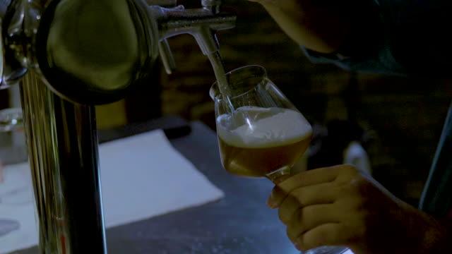 beer from the keg - pilsner stock videos & royalty-free footage