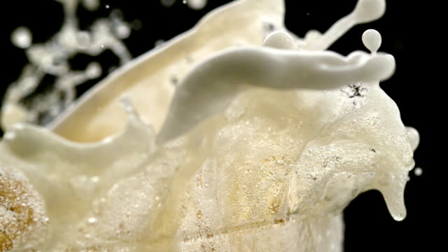 beer froth spilling out of glass. super slow motion - foam stock videos & royalty-free footage