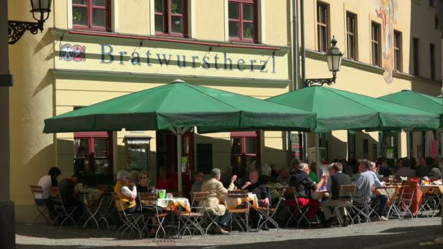 beer garden near viktualienmarkt, munich, bavaria, germany - western script stock videos & royalty-free footage