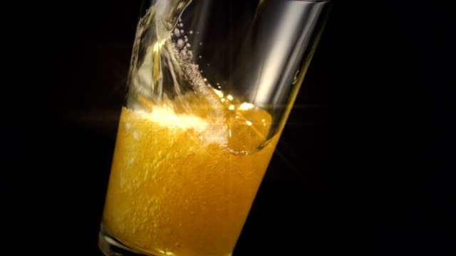 beer glass pour star filter - beer glass stock videos & royalty-free footage