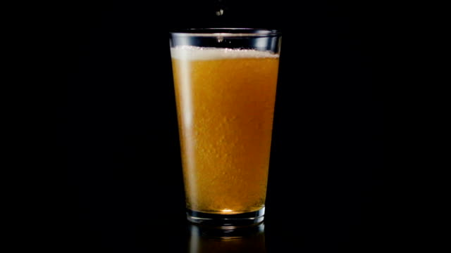 beer glass pour wide - beer glass stock videos & royalty-free footage