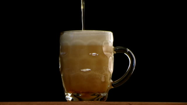 beer glass with frothy head - empty beer glass stock videos and b-roll footage
