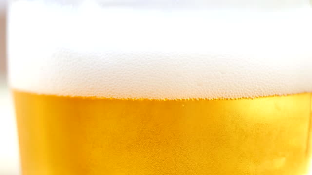 beer glass.bubble beer - beer glass stock videos & royalty-free footage