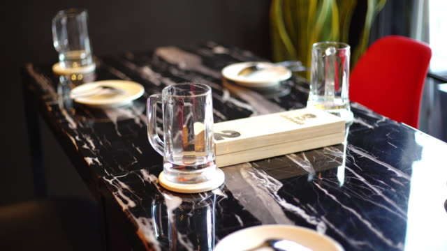 beer glasses on the table at restaurant - pilsner stock videos & royalty-free footage