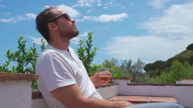 a beer in the sun - sunbathing stock videos & royalty-free footage