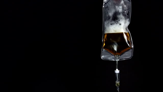 beer iv drip | video - drip bag stock videos and b-roll footage
