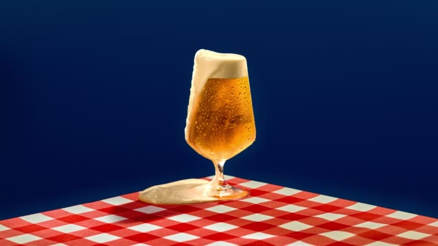 beer loop dripping over a graphic background - beer glass stock videos & royalty-free footage