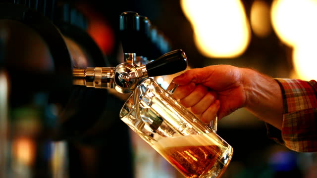 beer on a tap. - bar counter stock videos & royalty-free footage