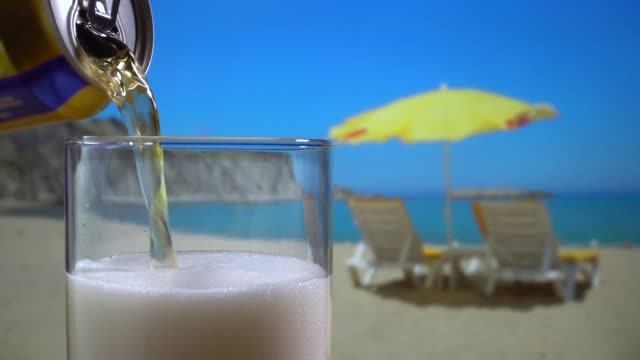 beer on the beach on a sunny day - deck chair stock videos & royalty-free footage