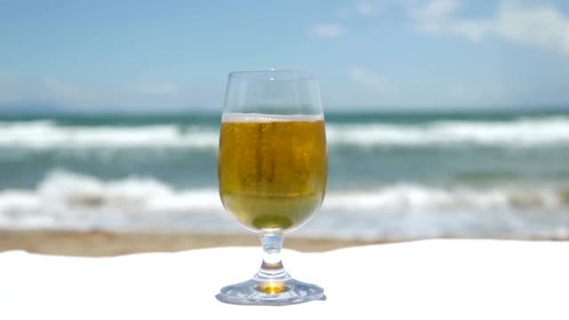 beer on the beach - empty beer glass stock videos and b-roll footage