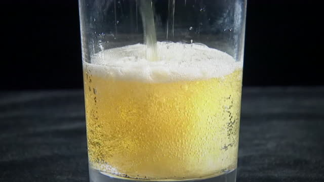 beer pour into glass - filling stock videos & royalty-free footage