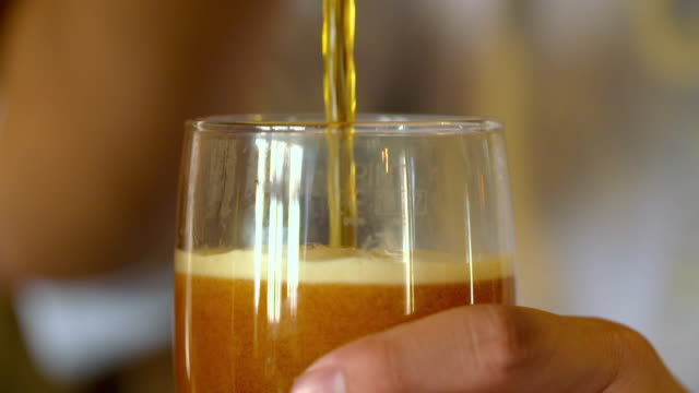 beer poured into pint glass - pint glass stock videos & royalty-free footage