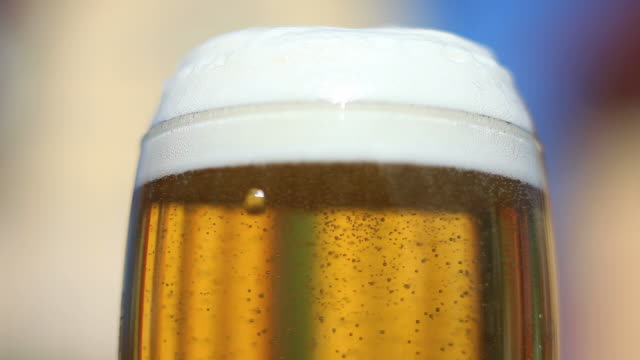 beer pouring into glass close-up - frische stock videos & royalty-free footage