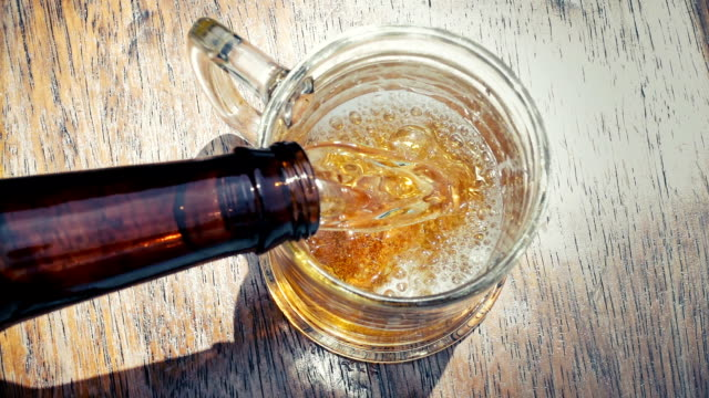 beer pouring into glass - frothy drink stock videos & royalty-free footage