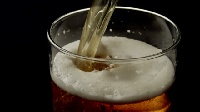 beer pouring - pint glass stock videos & royalty-free footage
