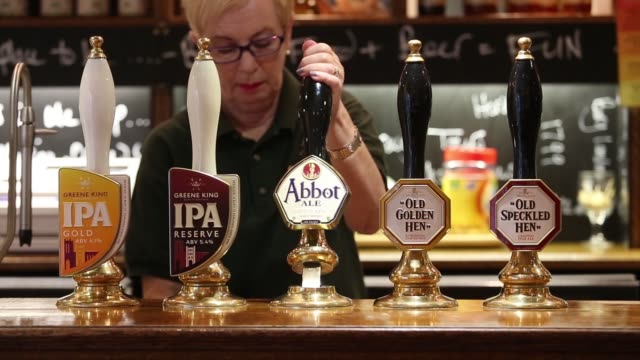 beer pumps displaying ales brewed by greene king plc stand on the bar at the company's tasting house in bury st edmunds uk on wednesday nov 19 an... - bury st edmunds stock videos & royalty-free footage