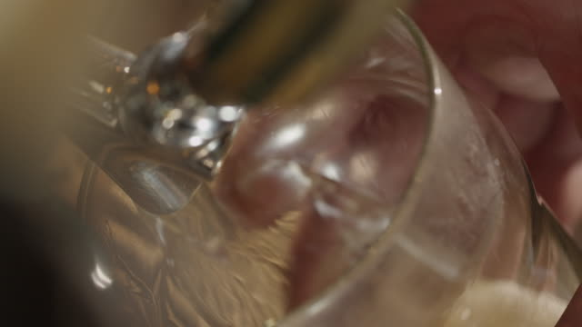 beer tap pulled to fill pint glass - pint glass stock videos & royalty-free footage