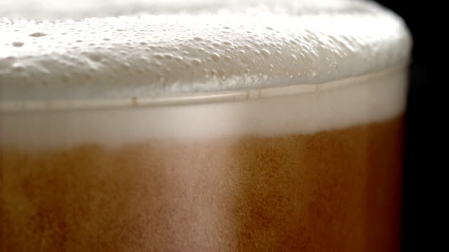 Beer with bubbles and foam. Extreme close up