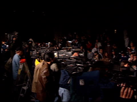 befind the line lots of photographers at the 'tomorrow never dies' premiere at dorothy chandler pavilion in los angeles california on december 16 1997 - pavilion stock videos & royalty-free footage