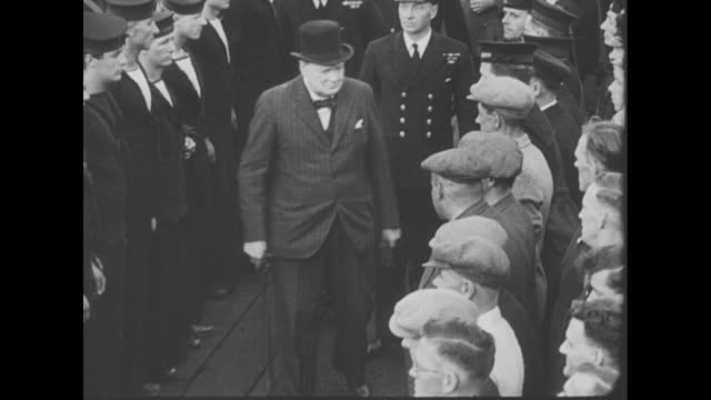 before boarding ship, churchill walks through crowd of british sailors / churchill shakes hands with british naval officers / [note: exact day/month... - winston churchill prime minister stock videos & royalty-free footage