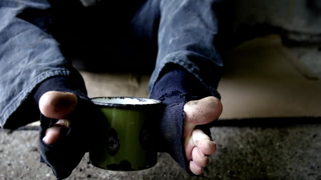 hd: beggar holding a cup with his feet - begging social issue stock videos and b-roll footage
