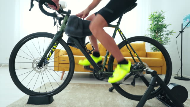i begin my day with a workout session. - bicycle stock videos & royalty-free footage